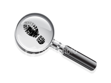 magnifying glass and footprint