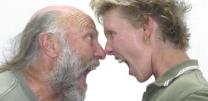 older man and younger woman yelling at each other